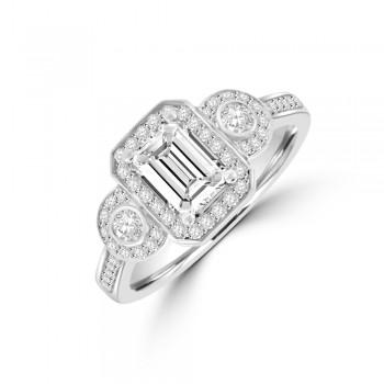 Platinum Three-stone Emerald & Brill cut Diamond Halo Ring